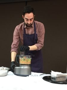 Jeffrey Yoskowitz uses a food processor to mix up the ingredients for a traditional serving of gefilte fish during a March 1 demonstration at The J (photo by Lee Chottiner)